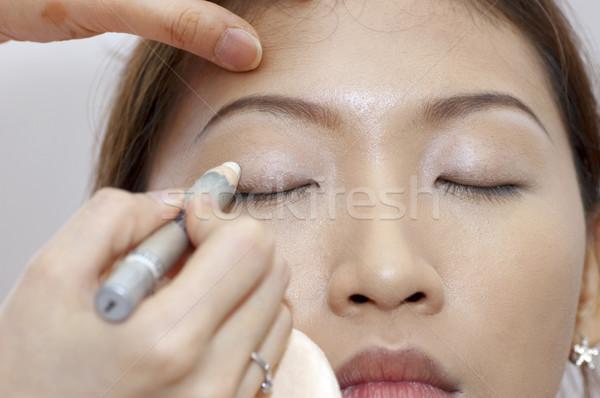 Applying makeup Stock photo © szefei