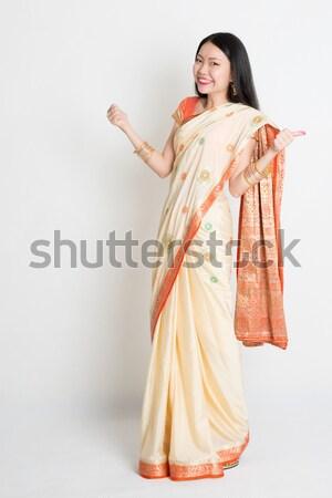 Side view woman in Indian sari dress greeting Stock photo © szefei
