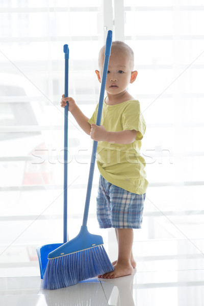 Young child sweeping floor Stock photo © szefei