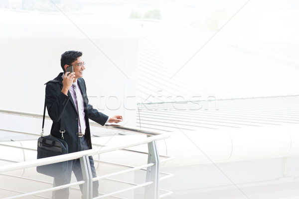 Candid Indian businessman talking on phone Stock photo © szefei