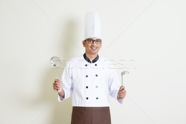 Indian male chef in uniform with kitchen tools Stock photo © szefei