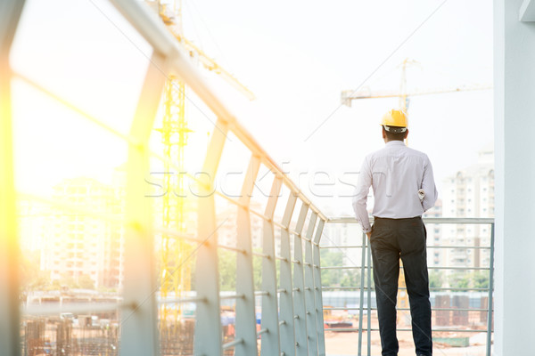 Back side of Asian Indian male site contractor engineer Stock photo © szefei