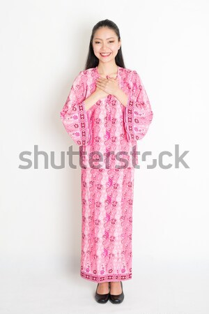 Southeast Asian girl greeting Stock photo © szefei