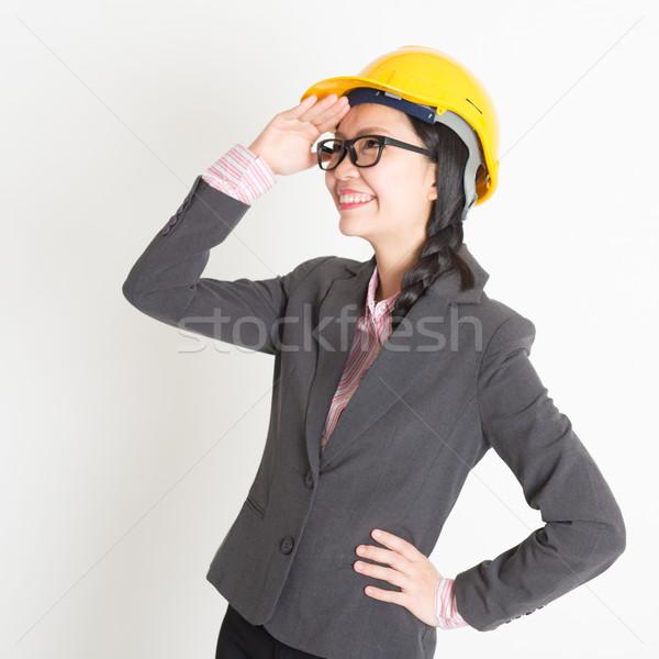 Female engineer looking away Stock photo © szefei