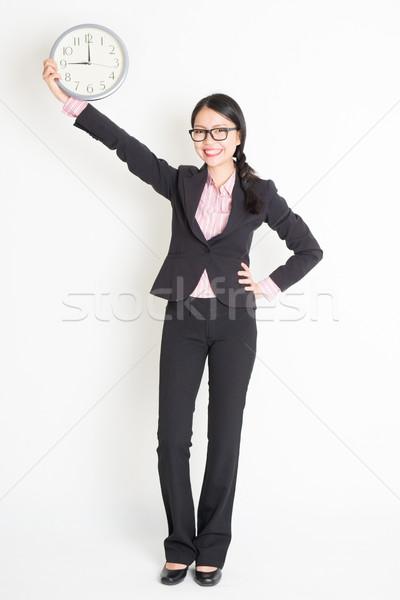 Asian businesswoman showing clock 9am Stock photo © szefei