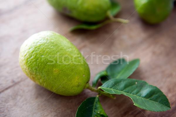 organic green lemons with leaves Stock photo © szefei