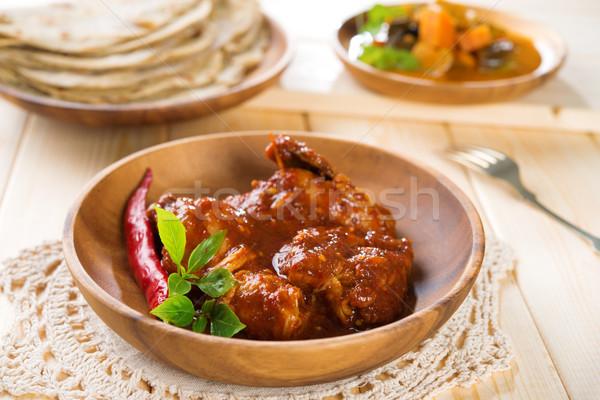 Indian curry chicken. Stock photo © szefei
