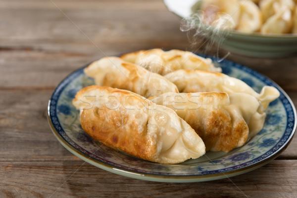 Asian maaltijd schaal vers knoedel Stockfoto © szefei