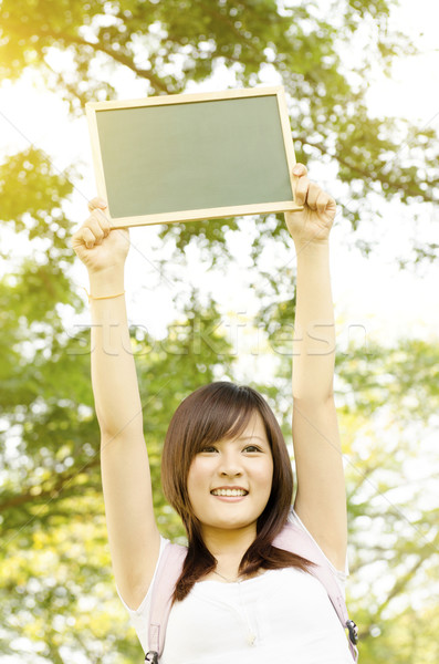 Asian college girl student with blank chalkboard Stock photo © szefei