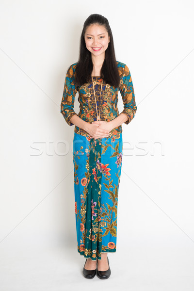 Southeast Asian girl in batik dress  Stock photo © szefei