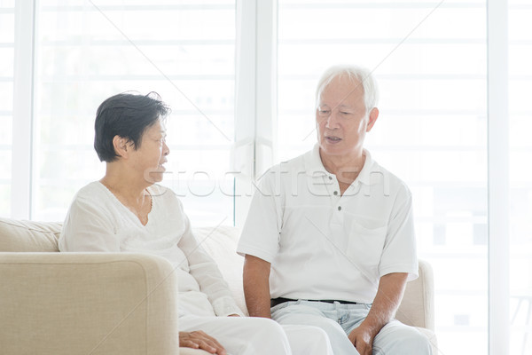 Old couple chatting at home Stock photo © szefei