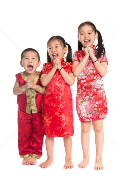 Little Asian children wishing you a happy Chinese New Year Stock photo © szefei