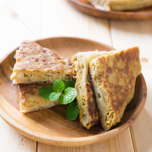 Pan fried stuffed bread murtabak Stock photo © szefei