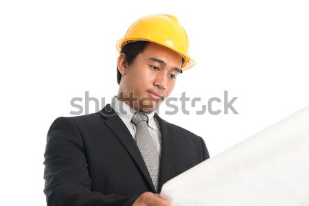 ázsiai férfi visel citromsárga munkavédelmi sisak néz Stock fotó © szefei
