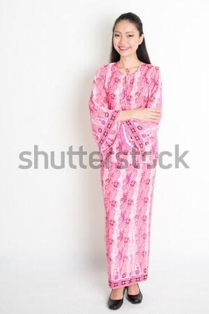 Portrait of Asian girl in pink batik dress Stock photo © szefei