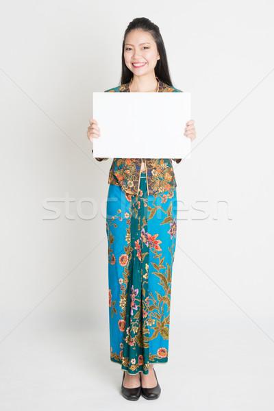 Asian girl holding a poster Stock photo © szefei