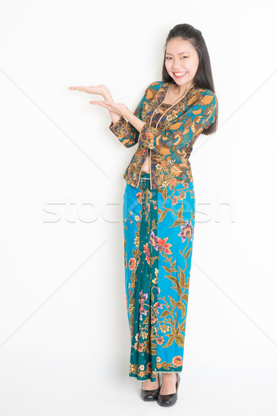 Happy girl hands holding something Stock photo © szefei