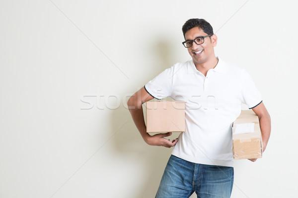 Koerier dozen levering dienst gelukkig indian Stockfoto © szefei