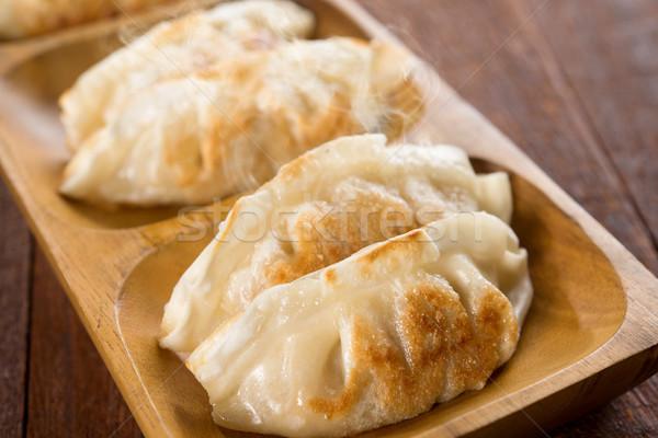 Close up pan fried dumplings Stock photo © szefei
