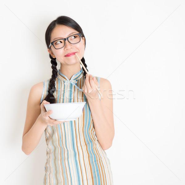 Ragazza mangiare bacchette pensare ritratto Foto d'archivio © szefei