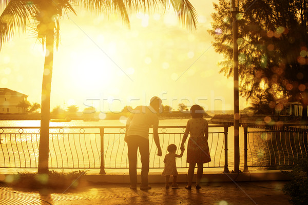 Family having fun in summer holiday vacations Stock photo © szefei