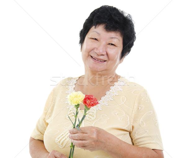 счастливым старший азиатских женщину гвоздика Сток-фото © szefei