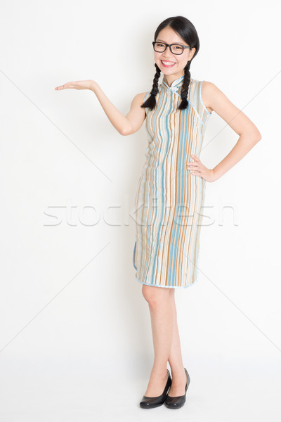 Asian Chinese girl palm holding something  Stock photo © szefei