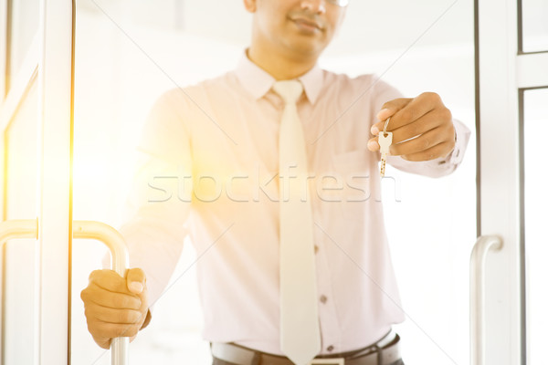 Asian Indian people holding office key Stock photo © szefei