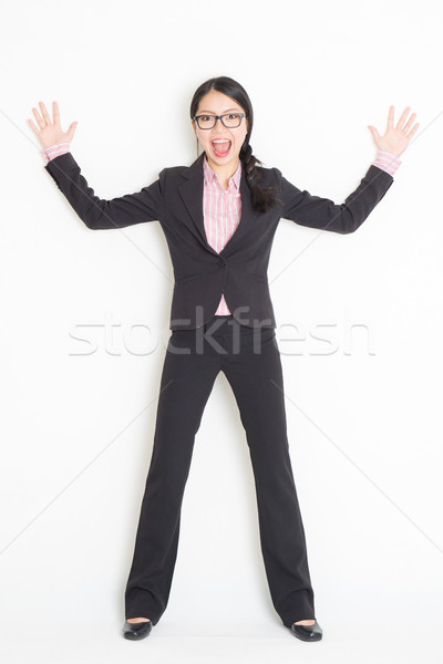 Shocked Asian businesswoman leaning wall Stock photo © szefei