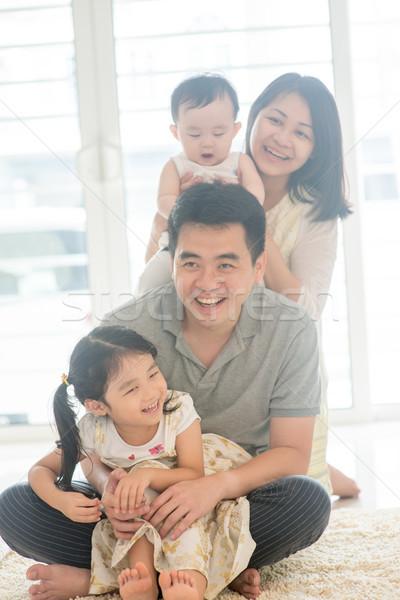 Happy Asian Family piggy back Stock photo © szefei
