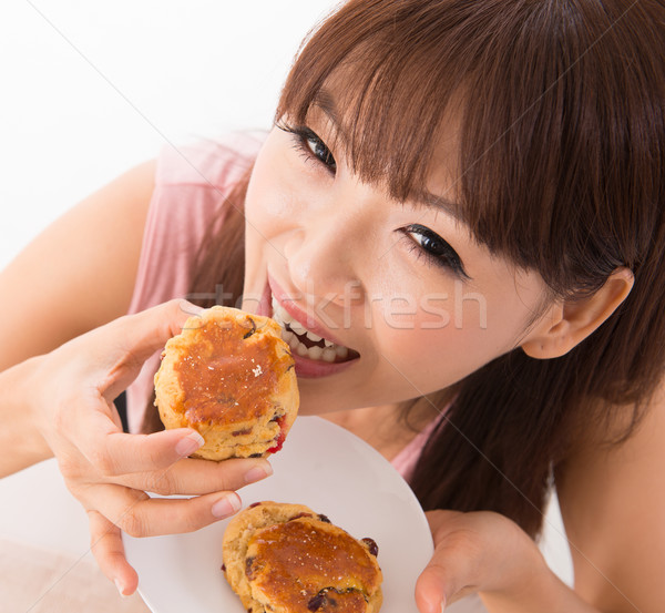 Enjoying scones Stock photo © szefei