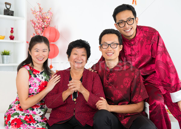 Asian family reunion. Stock photo © szefei