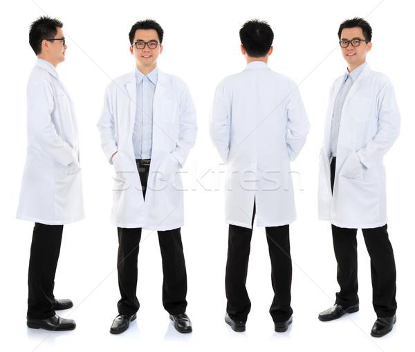 ázsiai férfiszépség terapeuta egyenruha egészalakos mosoly Stock fotó © szefei