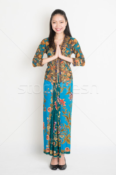 Asian female greeting Stock photo © szefei