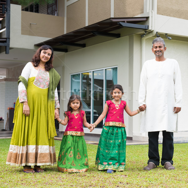 Indian family holding hands outside new home Stock photo © szefei