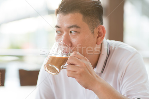 Mature man drinking milk tea Stock photo © szefei