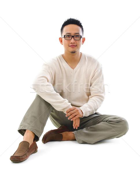 Asian man sitting on floor Stock photo © szefei