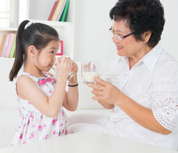 Drinking milk. Stock photo © szefei