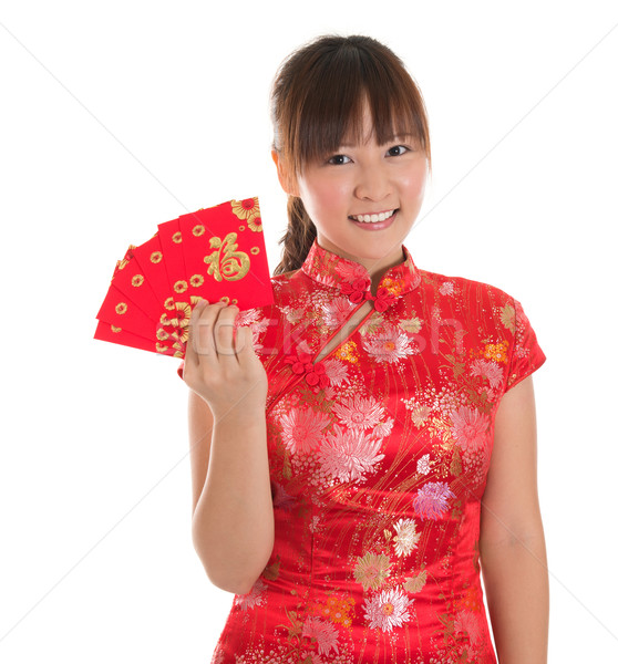 Chinese cheongsam girl showing red packets Stock photo © szefei