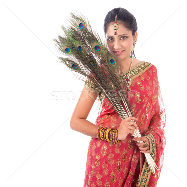 Beautiful Indian woman with peacock feathers Stock photo © szefei