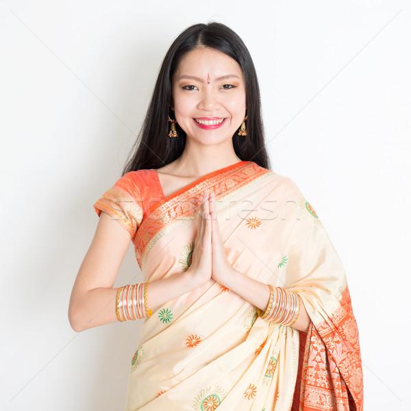 Woman with Indian greeting pose Stock photo © szefei