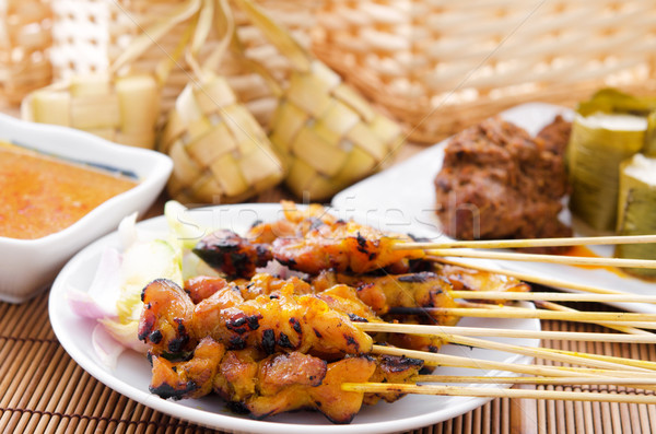 Chicken satay and ketupat  Stock photo © szefei