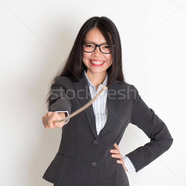 Asian female teacher smiling Stock photo © szefei