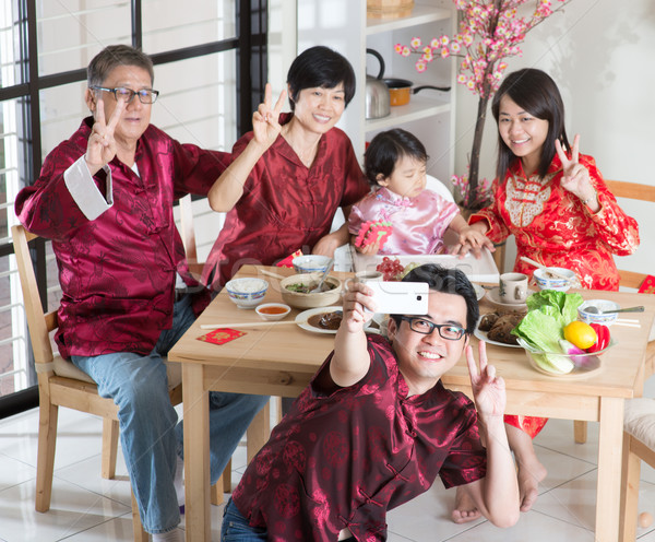 Chinese family selfie Stock photo © szefei