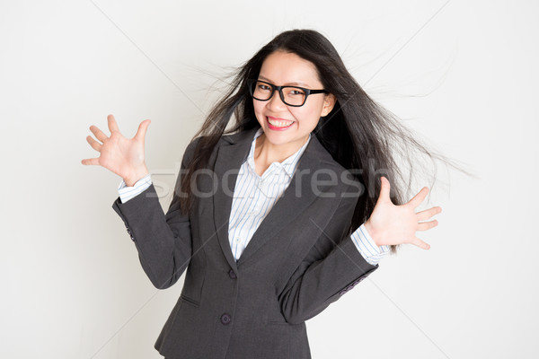 Stock photo: Portrait of happy Asian businesswoman