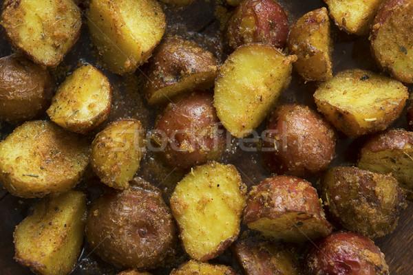 Oven baked potatoes close up Stock photo © szefei