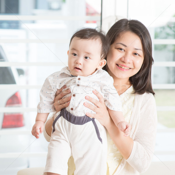 Mother holding baby son. Stock photo © szefei