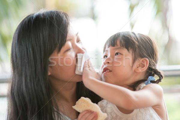Child wiping moms mouth  Stock photo © szefei