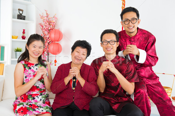 Asian family reunion at home. Stock photo © szefei