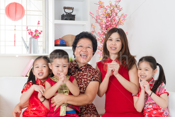 Happy Asian family reunion at home. Stock photo © szefei